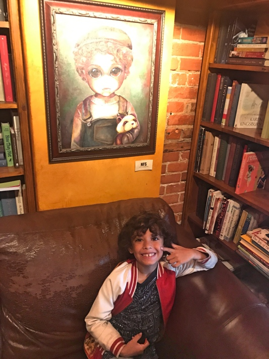 Judah Hossain with his painting at Raven Café.